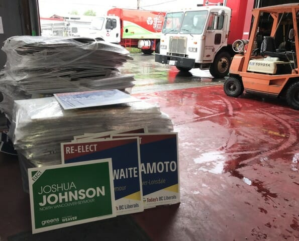 Large pile of plastic signs for recycling from BC Election